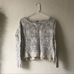 Crop floral sweater with zipper detail